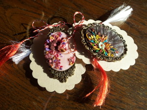Red and White ribbon are a mark for each Martisor. Spring Superstitions in Transylvania